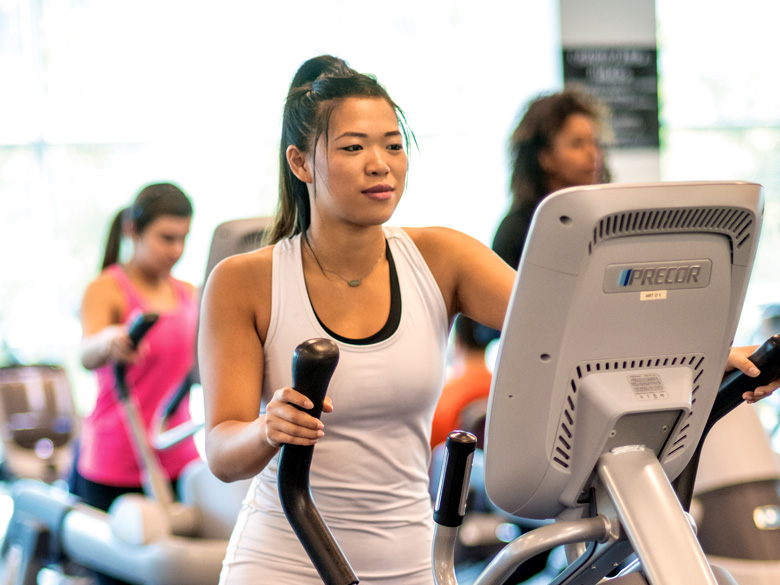 Student on an elliptical machine
