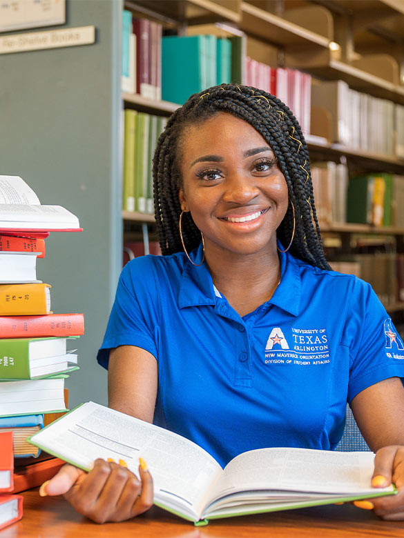 New Maverick Orientation Leader researching in the Central Library.