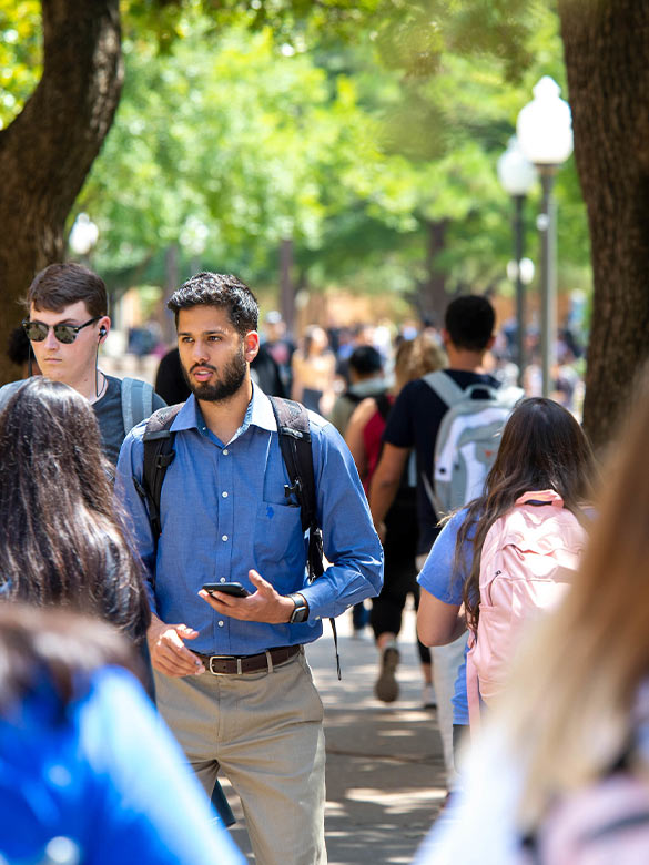Students walking down central library plaza.