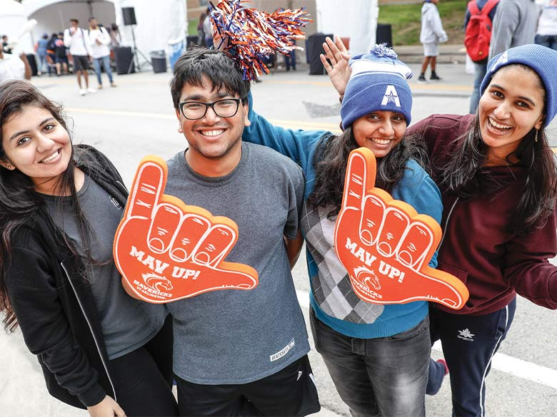 Students pose for picture at the 2019 Homecoming Parade
