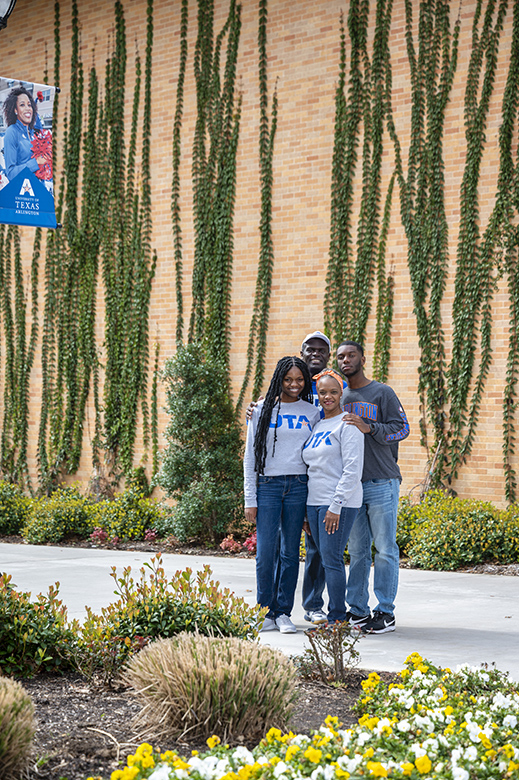 Family posing in front the Life Science building