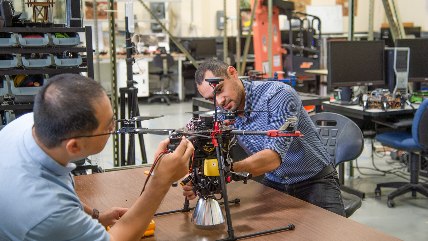 Researchers working on a drone