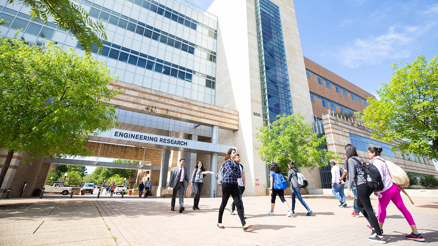 Students walking in front of the engineering research building