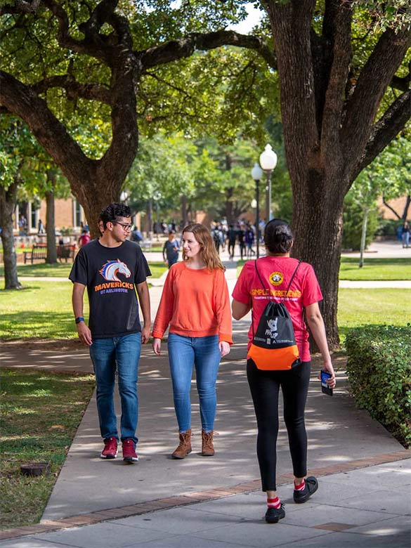 Students walking on campus in front of Central Library.