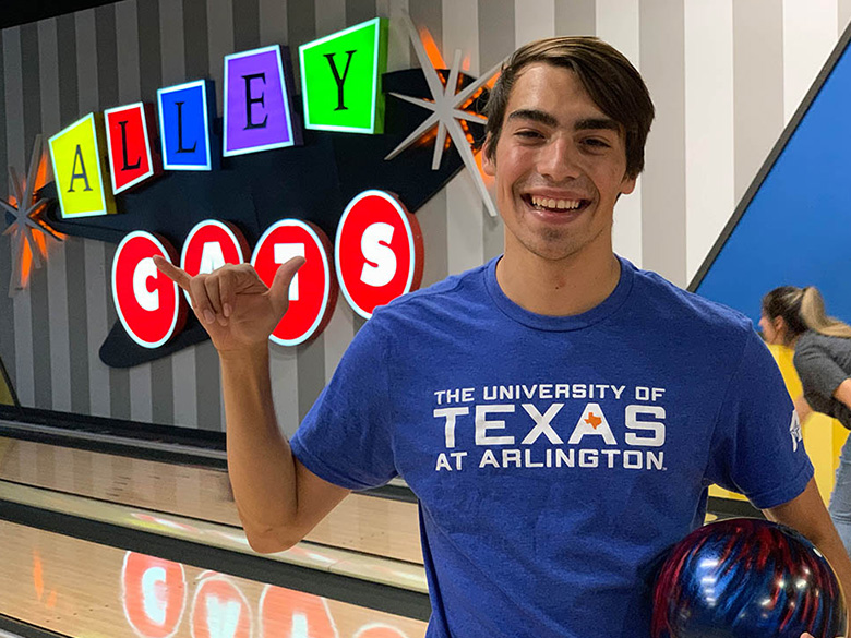 Student bowling at Alley Cats