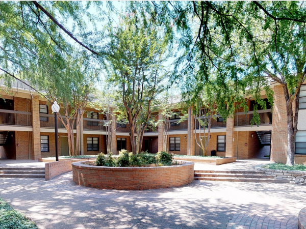 University Village Apartments Exterior with circular entrance and trees