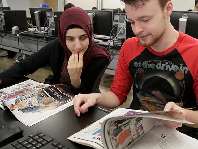 Students flipping through magazines
