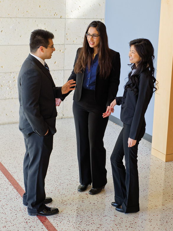 COB Students standing and talking in business attire