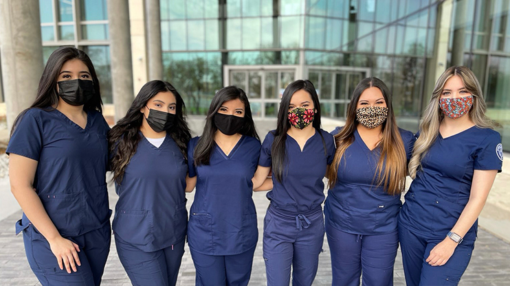 Hispanic Student Nursing Association group photo in front of S E I R Building