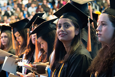 Row of students wearing caps and gowns during a commencement ceremony