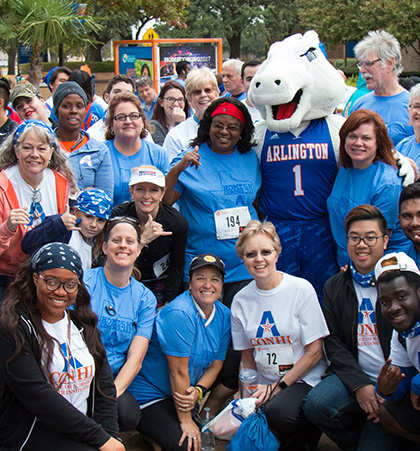 A group of students and faculty pose with Blaze before the 5 K run.