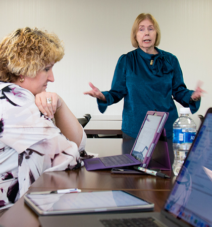 Donna Hamby teaches to a class of doctoral students