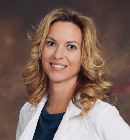 Portrait of Heather Skrivanek wearing a white coat.
