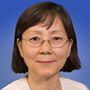 Portrait of Yaewon Seo with a blue background