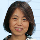 Portrait of Jing Wang in a lecture setting