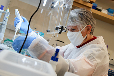 Researcher at North Texas Genome Center demonstrates equipment