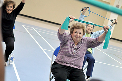Senior ladies exercising with stretch bands