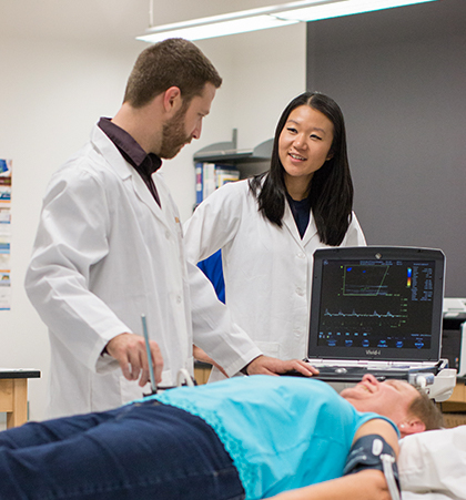 Dr. Ryan Rosenberry and Susie Chung study a patient in the Applied Physiology and Advanced Imaging Laboratory.