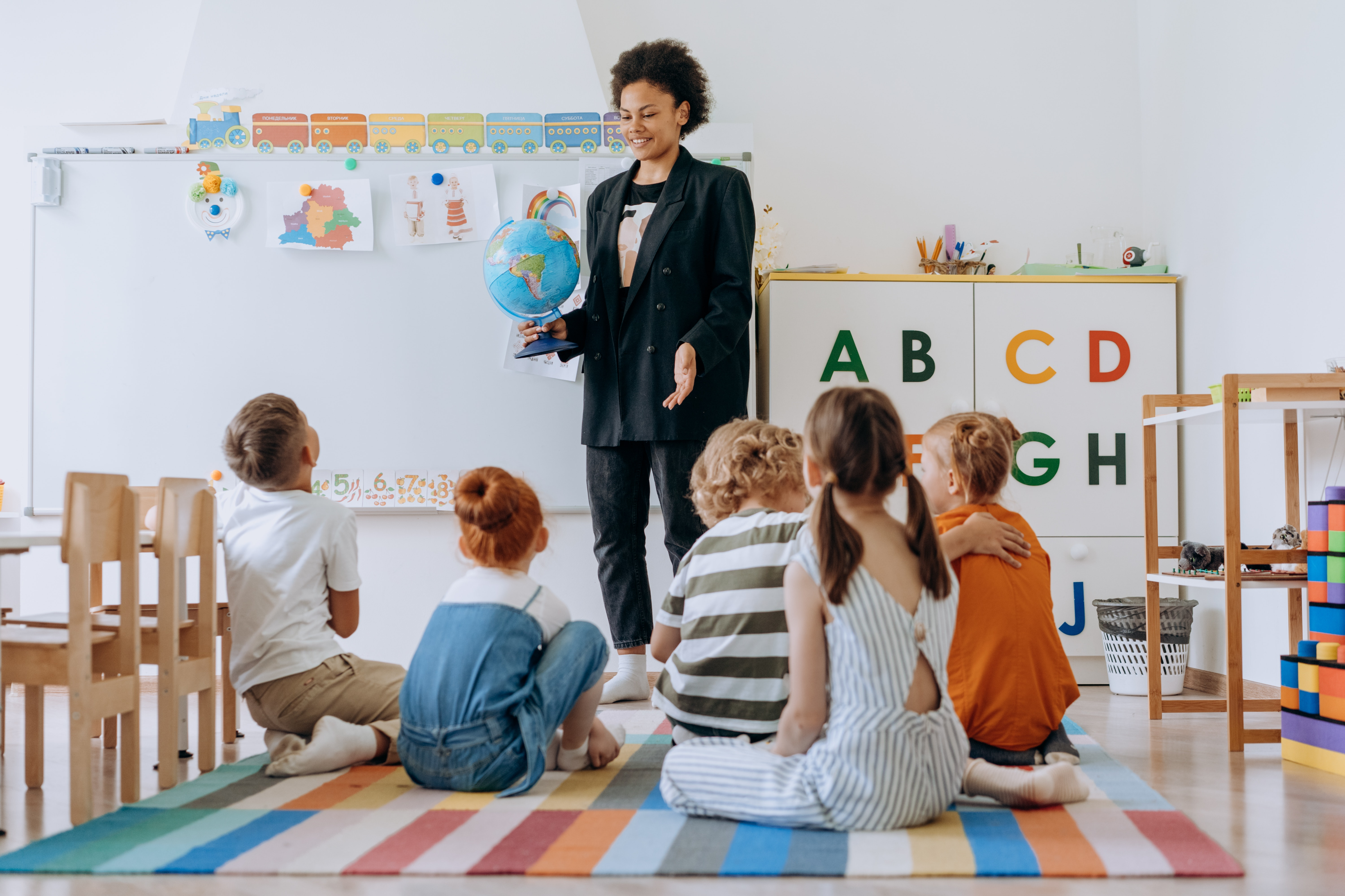 A teacher works with students in a classroom