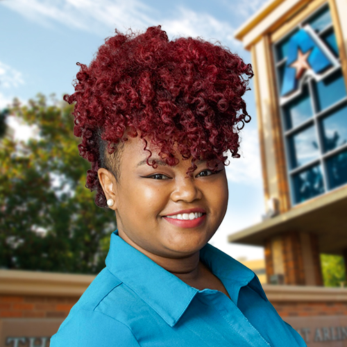 Headshot of University of Texas at Arlington employee Jhonniece Meeks. The background shows a UTA campus sign.