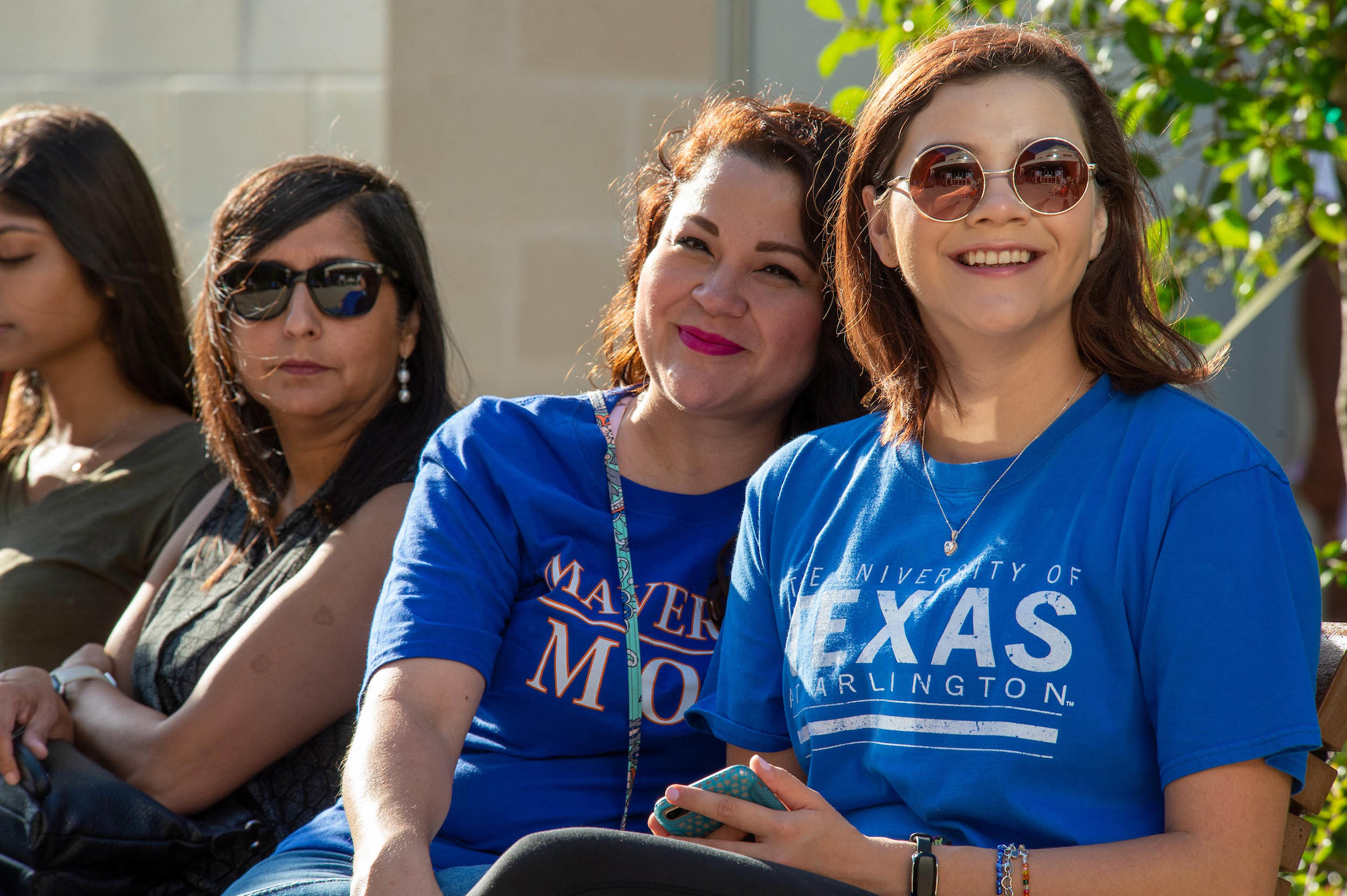 A UTA student pictured with her mom. Both are wearing UTA shirts.