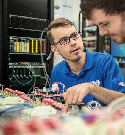 """Electrical Engineering Students in lab"""" width=""""420"""" src=""""https://cdn.web.uta.edu/-/media/project/website/engineering/electrical-department/engineering_ee_front_what.ashx?la=en&h=451&w=420"""" _languageinserted=""""true"""