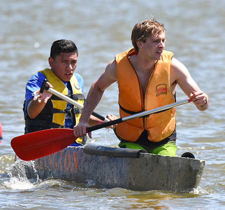 UTA concrete canoe team paddling in the water