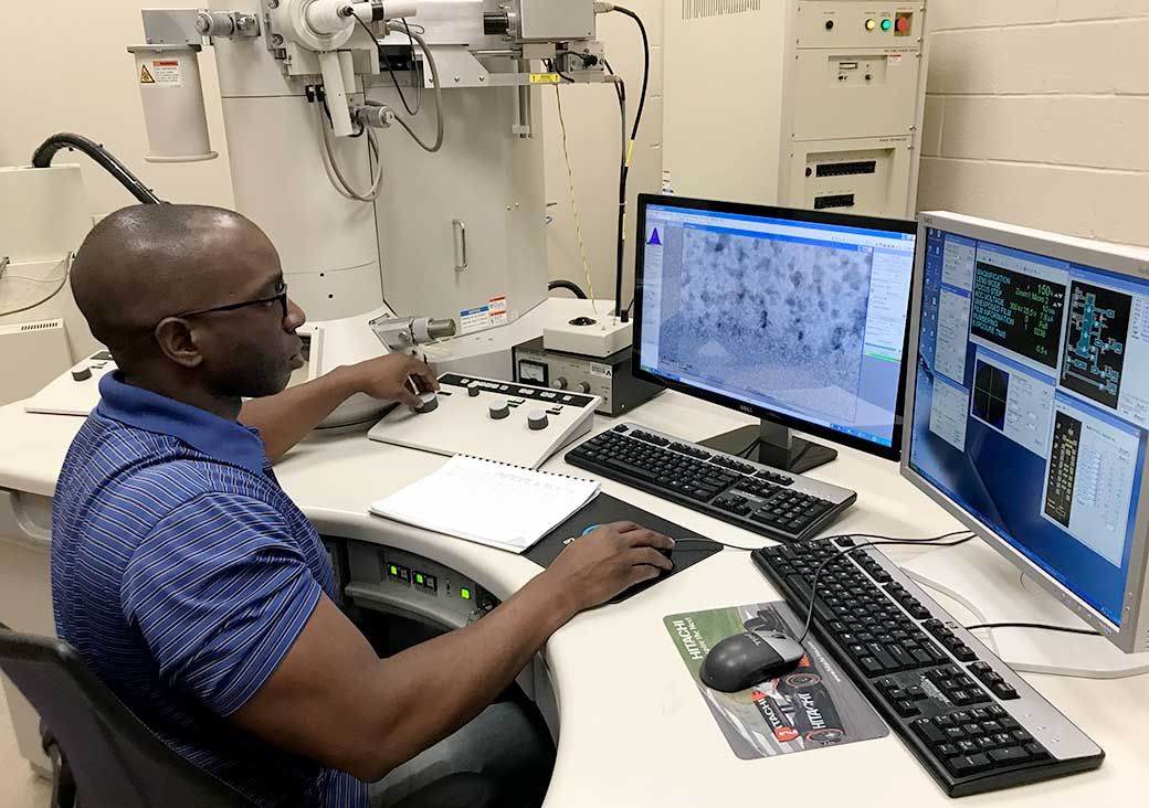 A UTA Materials Science and Engineering student works with electron microscope imaging
