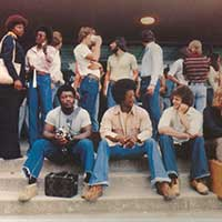 Students hanging out on the steps of an engineering building