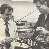 Dr. Bob Woods and a mechanical engineering student inspect a Formula SAE engine