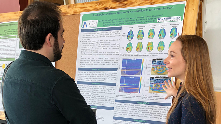 Elizabeth Lyde, a 2nd year NIH T32 Fellow, shares her research with fellow Ph.D. candidate Caleb Liebman.