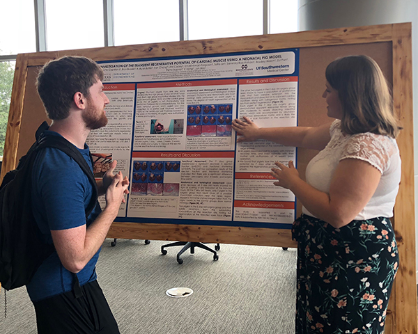 Katherine Copeland explains her research to Alan Taylor, a 1st year NIH T32 Fellow.