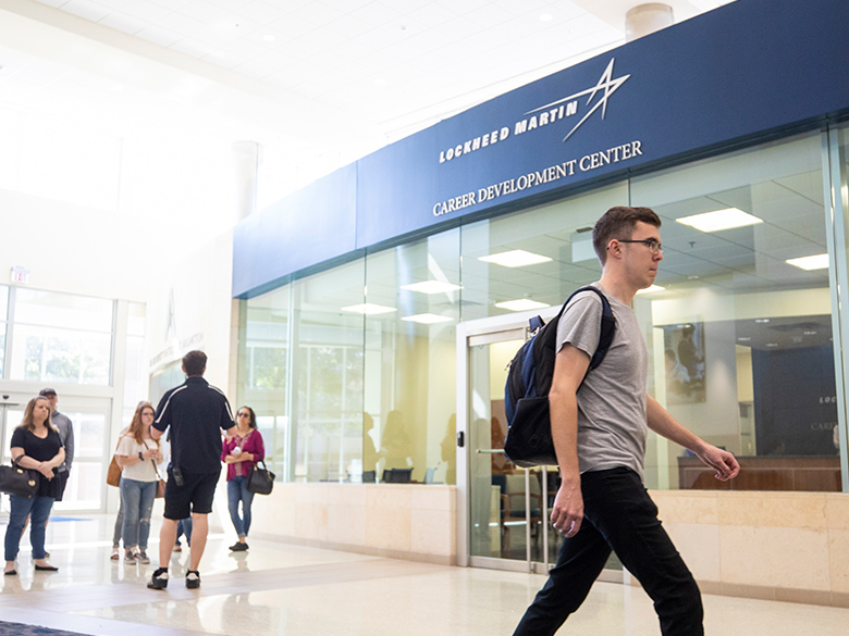 Students walking in front of the Lockheed Martin Career Development Center