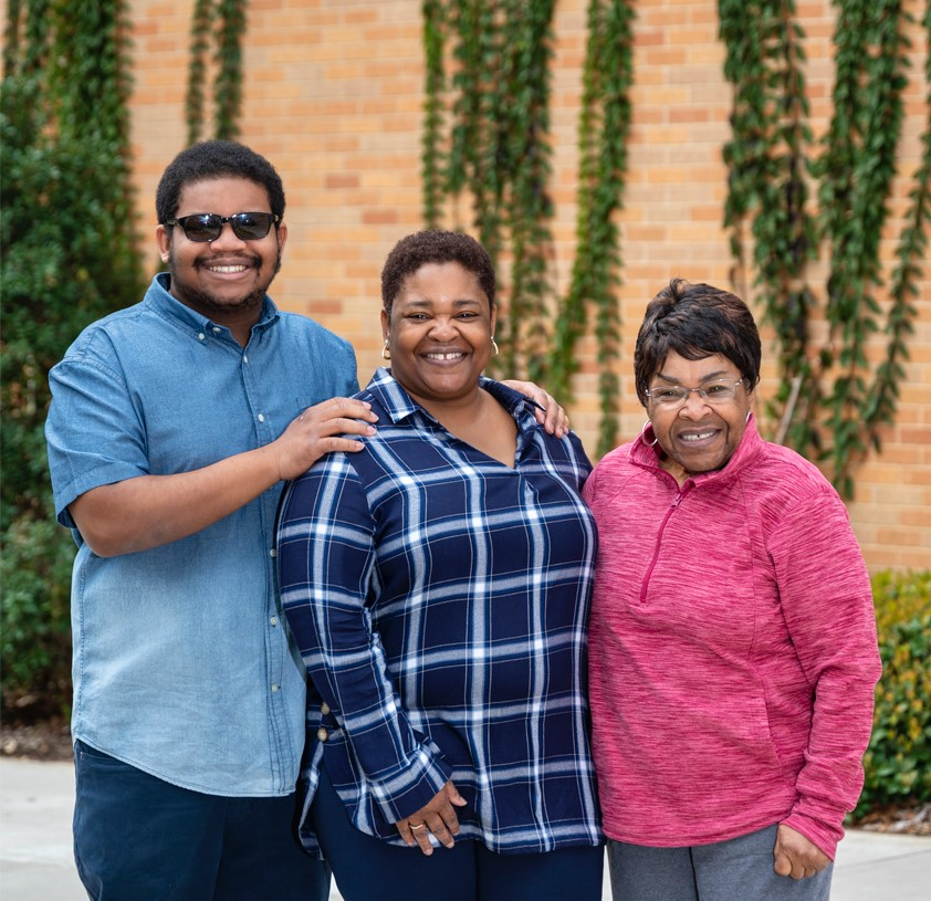 Forde Harris family smiling on campus