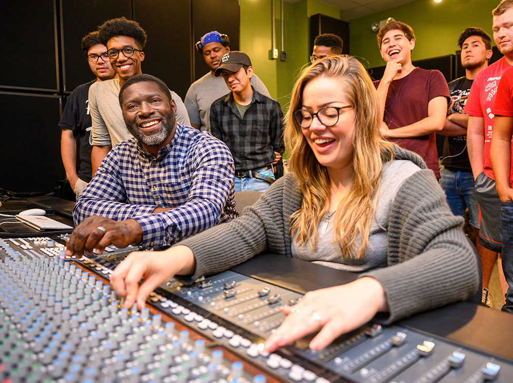 Jamar Jones, left, and students from the record label studio management class.