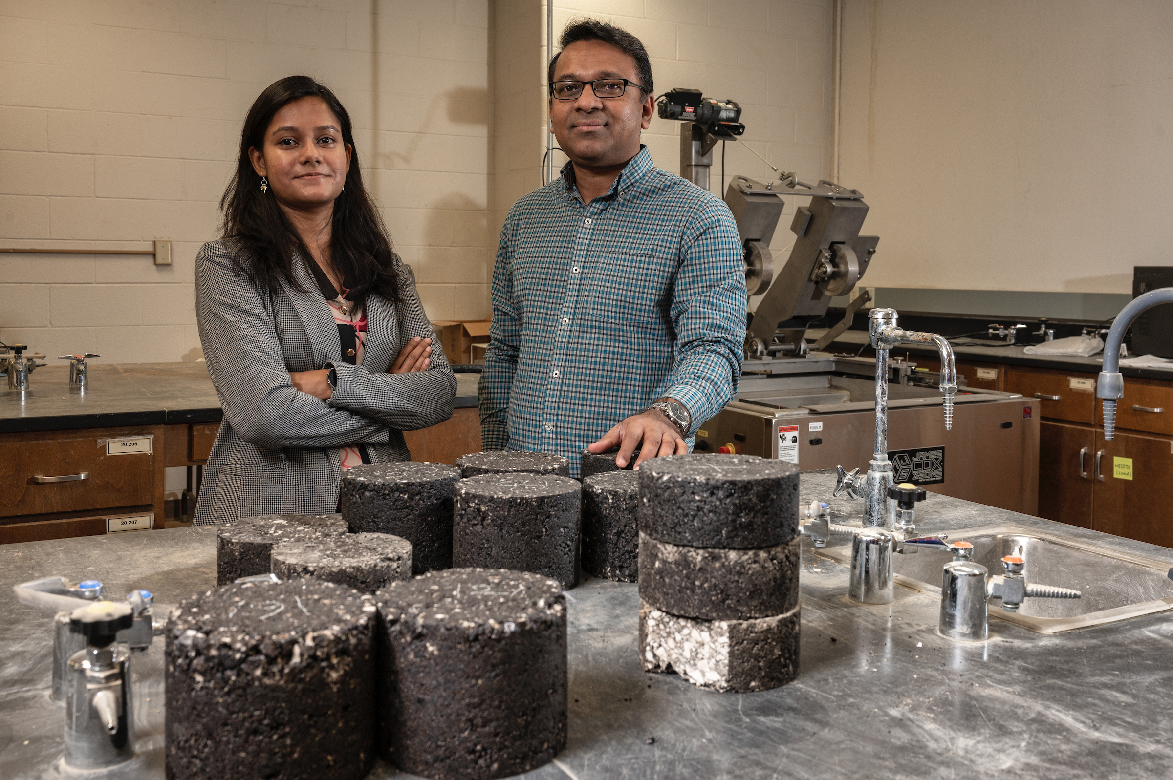 "Sahadat Hossain and Warda Ashraf pose with composite materials for road construction"" _languageinserted=""true"