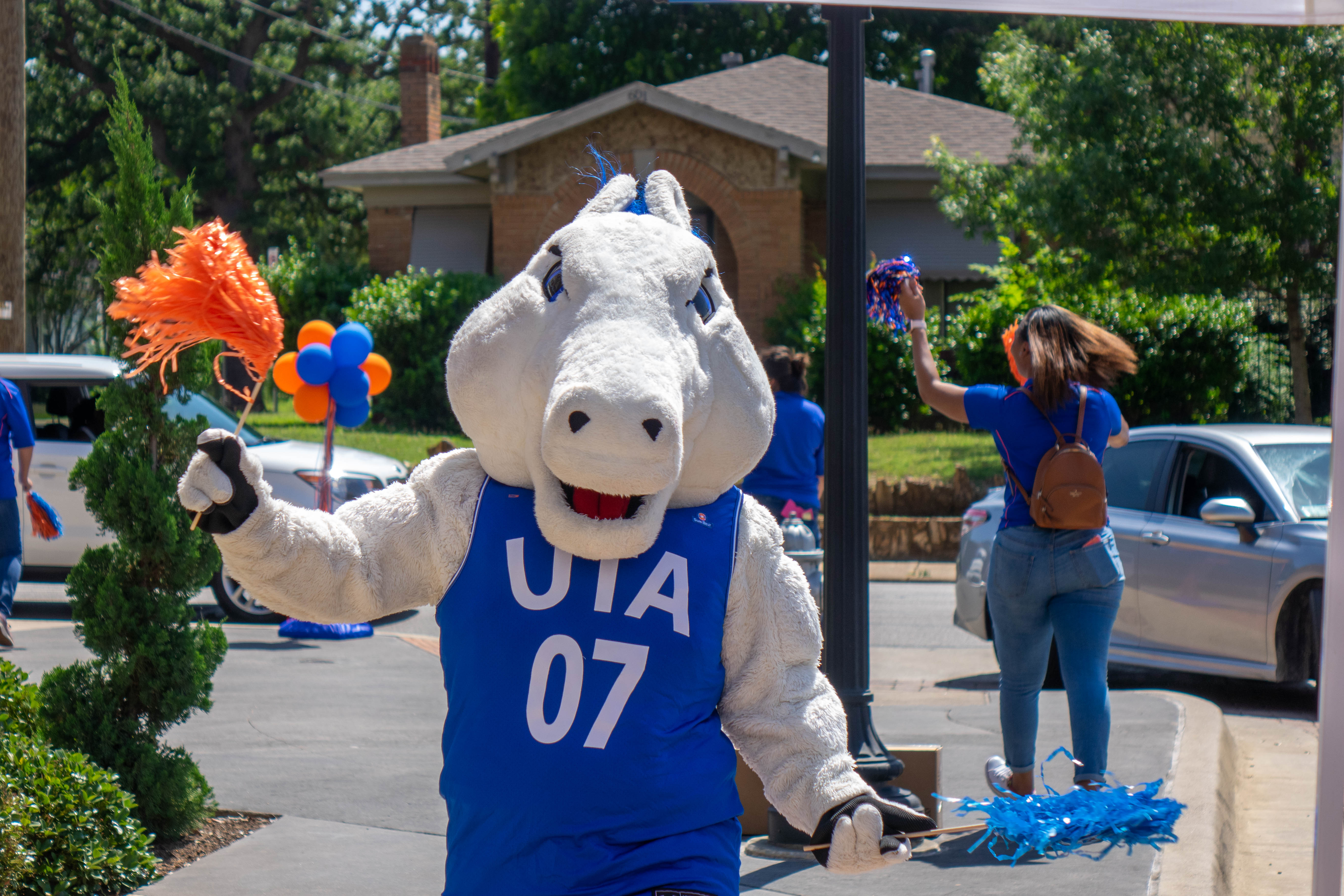 "Blaze the mascot at drive-thru event May 2020"" width=""5472"" _languageinserted=""true"" src=""https://cdn.web.uta.edu/-/media/project/website/news/releases/2020/05/drive-thru2.ashx?la=en"