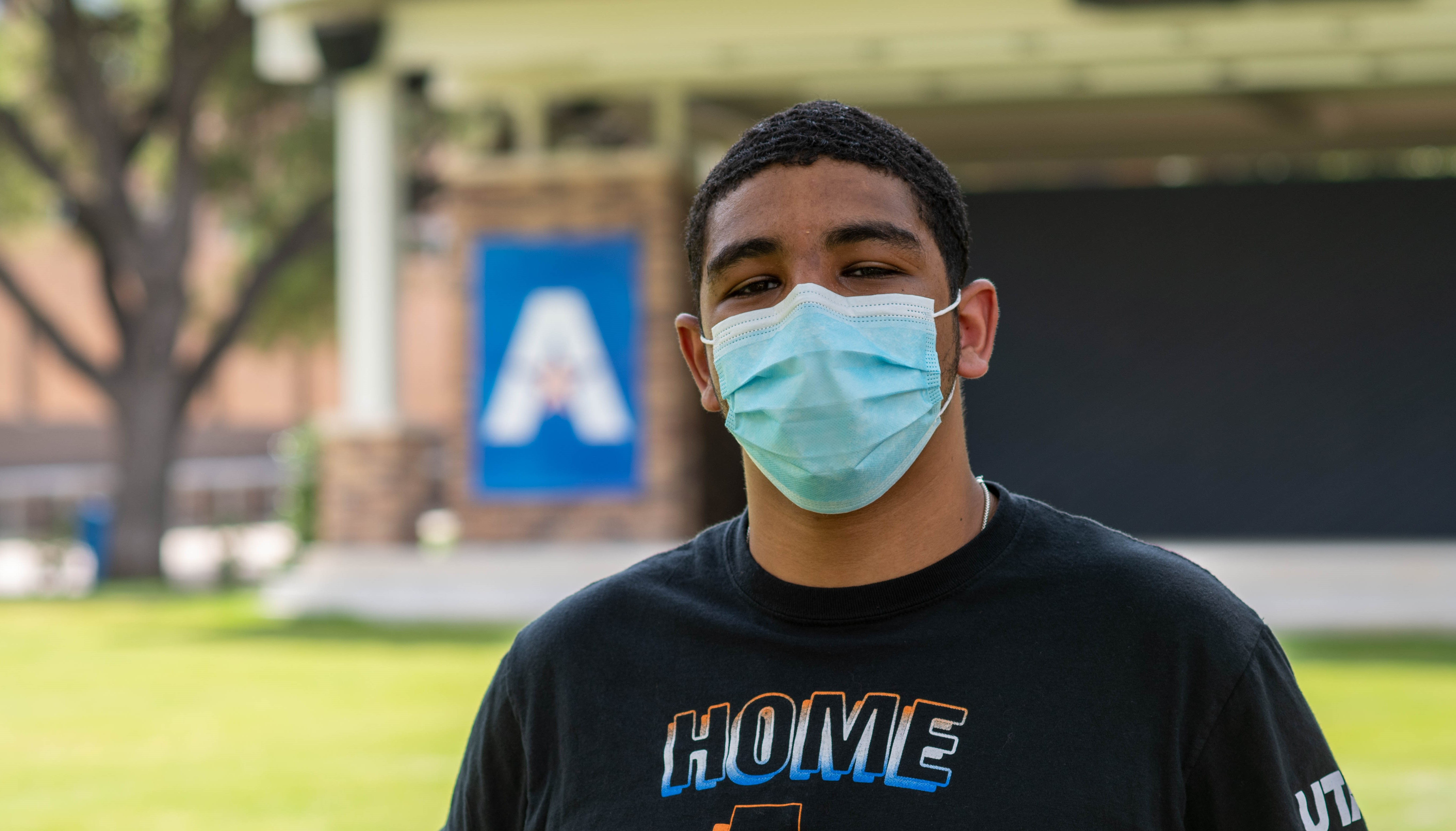 UTA Student outside with a mask on