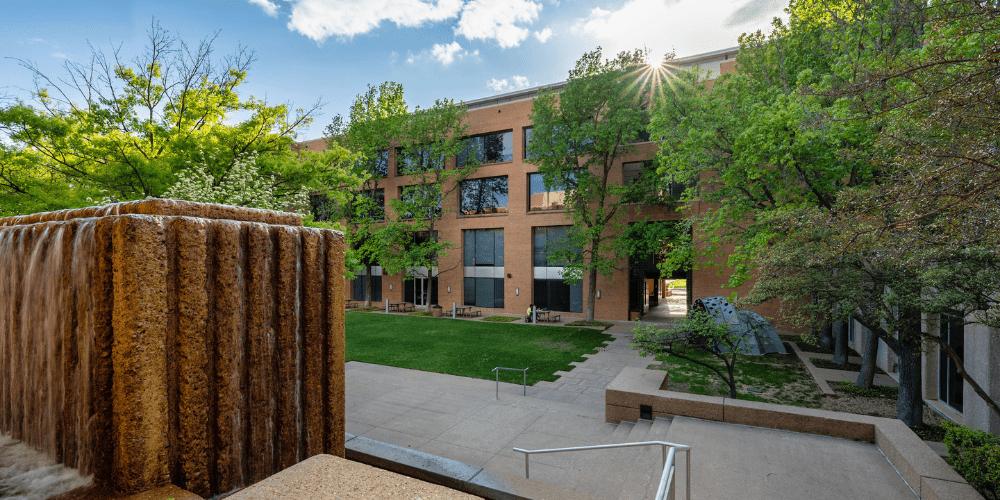 A green courtyard outside of UTA