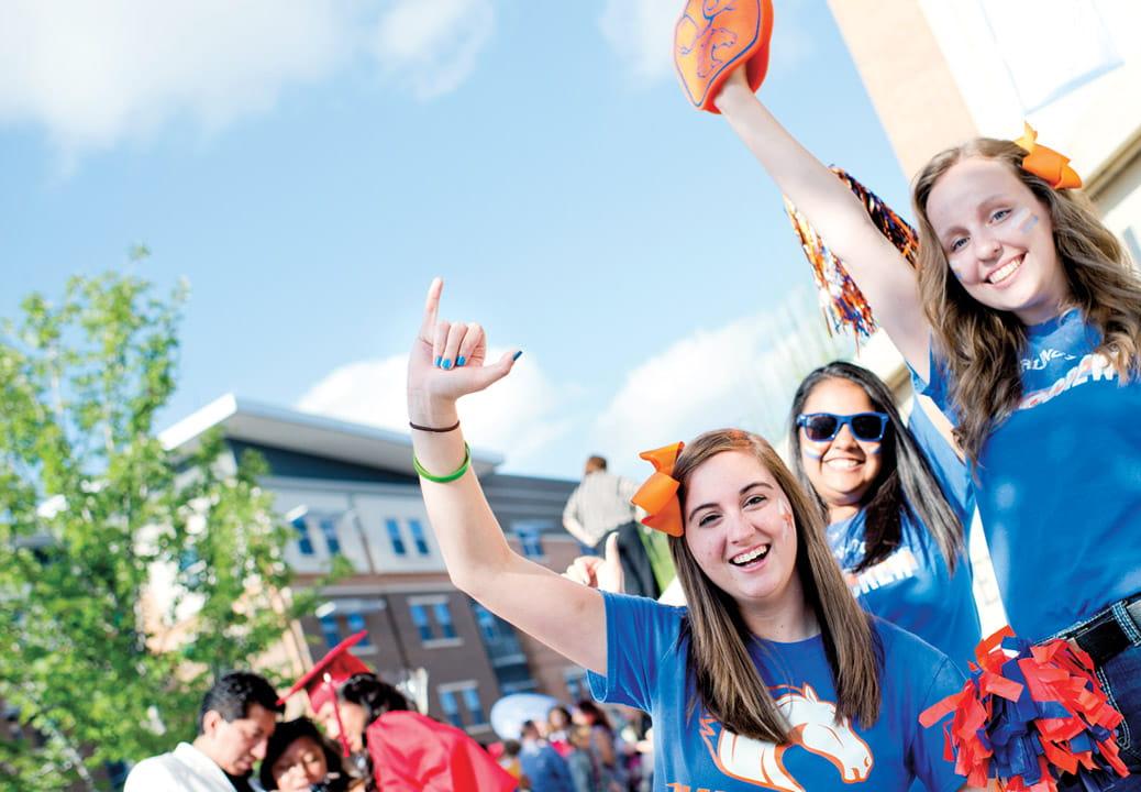 Freshmen students cheering.