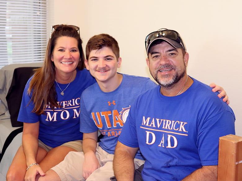 Parents and son wearing UTA spirit shirts