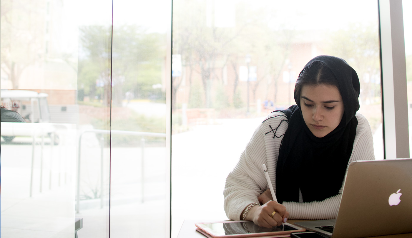 student studying in seir building