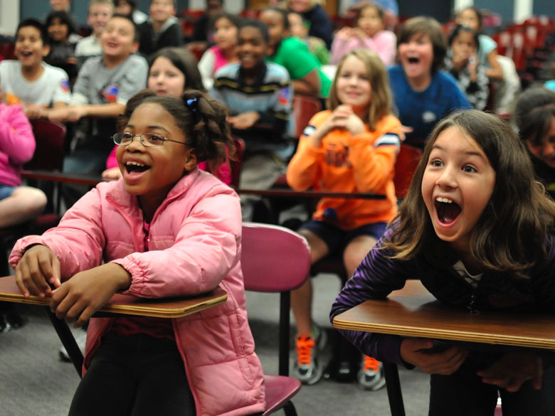 Students delight in the performance at a Science Ambassadors show.