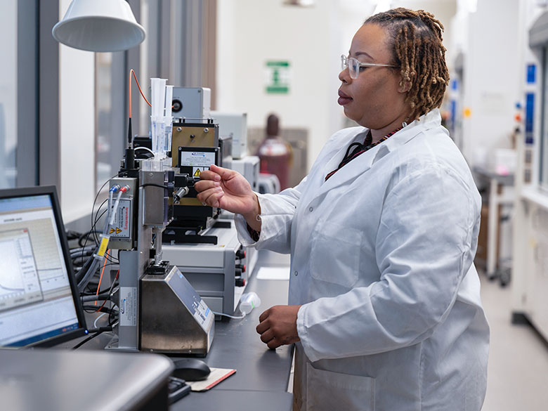 A graduate student works in a lab.