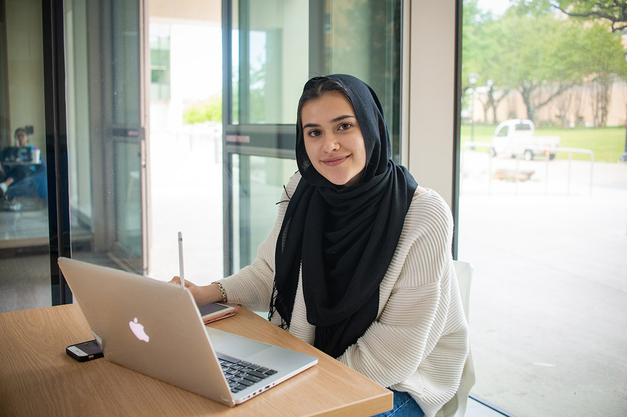 student studying in seir building in the uta campus.