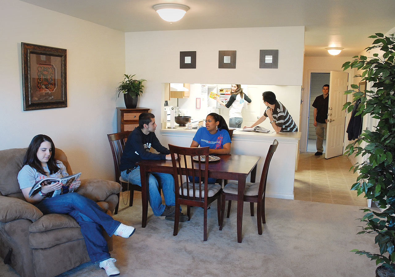 students sitting in their apartment
