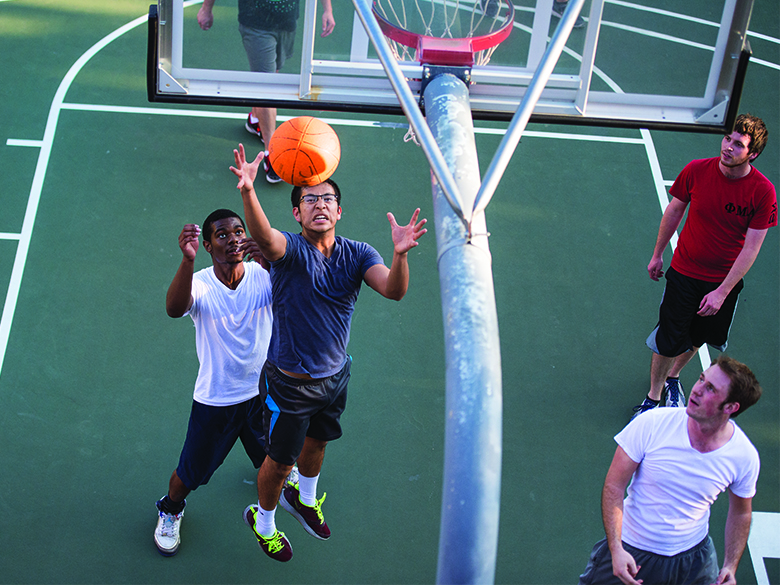 Students playing basketball outside of the MAC