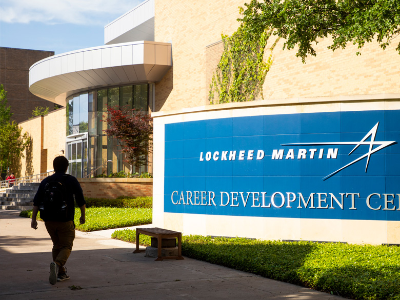 Student in front of the Lockheed Martin Career Development Center