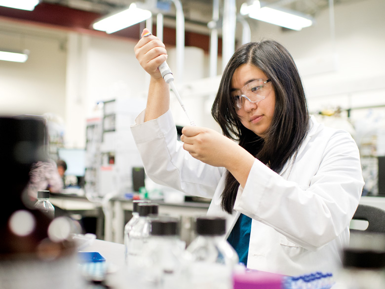 Graduate Student evelyn wang working in a lab
