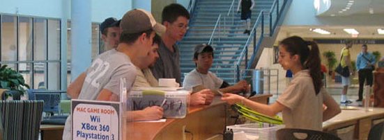 Student employee checking in a group of students at the MAC